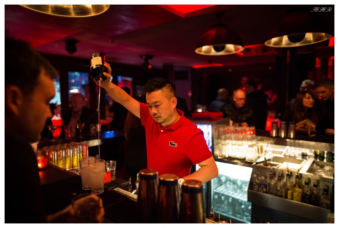 The barman does his stuff at one of Shanghai's best bars. Fantastic roof top bar. 5D Mark III   24mm 1.4 Art