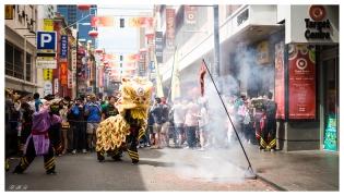 Lion dancing to firecrackers
