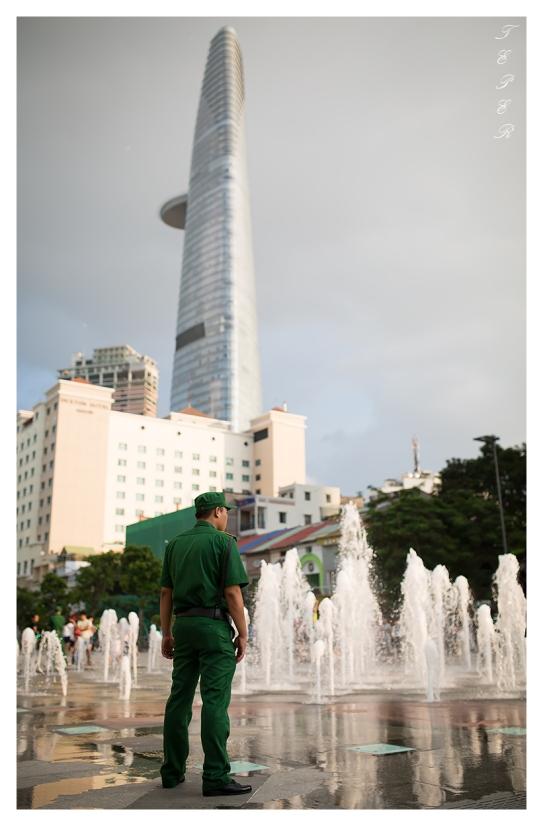 Gaurd keeps a watchful eye, Saigon. 5D3   35mm 1.4A   f2.0