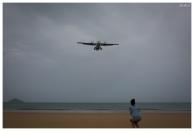 The aircraft fly straight over the beach. 5D Mark III   35mm 1.4 Art